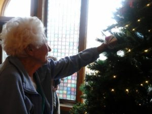 Azura of Beloit residents help trim the tree as part of our reminiscent therapy.